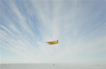 A plane takes off from an ice runway near the Applied Physics Lab Ice Station to return to Prudhoe Bay in the Arctic north of Prudhoe Bay, Alaska March 18, 2011. REUTERS/Lucas Jackson