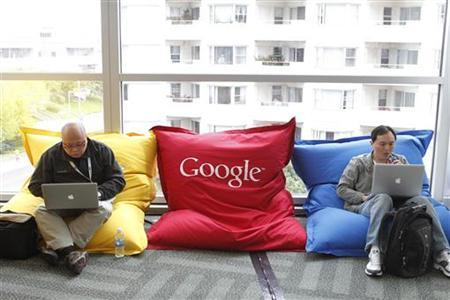 Attendees Dominie Liang (L) and Ruslan Belkin utilize the common area at the Google I/O Developers Conference in the Moscone Center in San Francisco, California, May 11, 2011. REUTERS/Beck Diefenbach