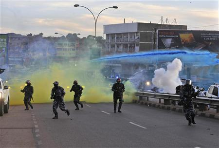 Ugandan anti-riot policemen fire coloured tear gas canisters to disperse supporters of opposition Forum for Democratic Change during a procession to welcome their leader Kizza Besigye in the capital Kampala May 12, 2011. REUTERS/James Akena