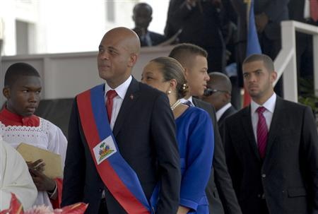 Haiti's President Michel Joseph Martelly (2nd L) is followed by members of his family during his inauguration ceremony in Port-au-Prince May 14, 2011. REUTERS/Swoan Parker