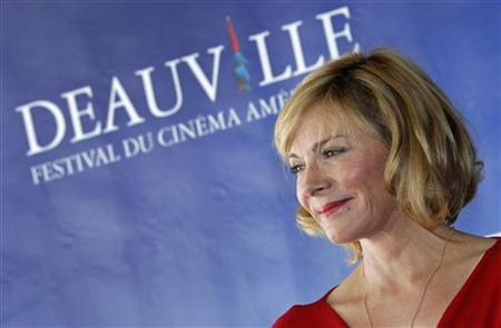 Cast member Kim Cattrall poses during a photocall for the film ''Meet Monica Velour'' at the 36th American film festival in Deauville September 11, 2010. REUTERS/Vincent Kessler