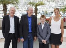 "<p>(L-R) Directors Jean-Pierre and Luc Dardenne pose with cast members Thomas Doret and Cecile De France during a photocall for the film ""Le Gamin au velo"" in competition at the 64th Cannes Film Festival in Cannes, May 15, 2011. REUTERS/Yves Herman</p>"