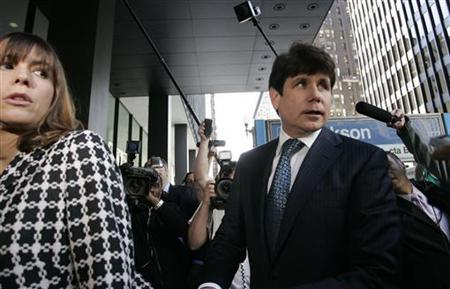 Former Illinois Governor Rod Blagojevich (R) and his wife Patti enter the Dirksen Federal building for the start of his corruption trial in Chicago, Illinois June 3, 2010. REUTERS/Frank Polich