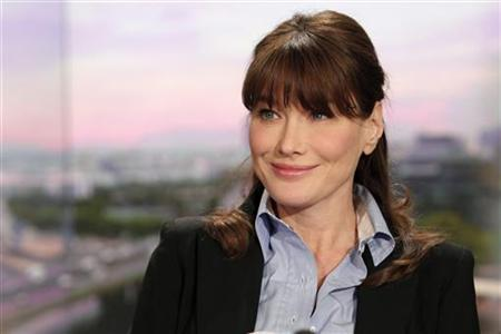 Carla Bruni-Sarkozy, France's first lady, poses prior to a television interview during a live broadcast at French TF1 television studios in Paris, May 16, 2011. REUTERS/Thibault Camus/Pool