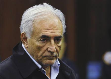 IMF chief Dominique Strauss-Kahn listens as he stands before judge Melissa Jackson during his arraignment in Manhattan Criminal Court in New York,  May 16, 2011. REUTERS/Emmanuel Dunand/Pool