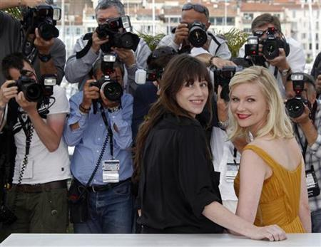 Cast members Charlotte Gainsbourg (L) and Kirsten Dunst pose during a photocall for the film ''Melancholia'', by director Lars Von Trier, in competition at the 64th Cannes Film Festival, May 18, 2011. REUTERS/Jean-Paul Pelissier