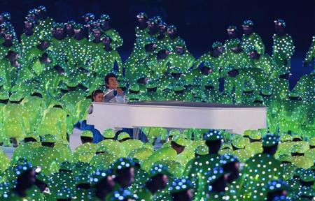 Pianist Lang Lang performs during the opening ceremony of the Beijing 2008 Olympic Games at the National Stadium, August 8, 2008. REUTERS/Mike Blake