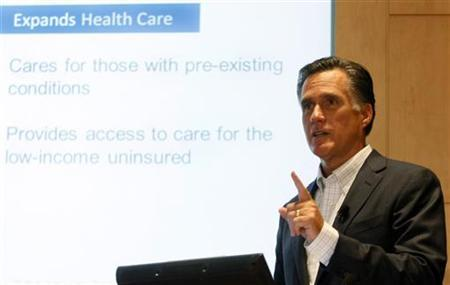 Former Massachusetts Governor and likely Republican presidential candidate Mitt Romney uses a powerpoint presentation as he speaks about the healthcare plans he backed as Governor during a stop at the University of Michigan Cardiovascular Center in Ann Arbor, May 12, 2011. REUTERS/Rebecca Cook