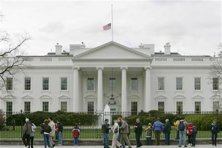 Tourists walk past the White House in Washington in this file photo. REUTERS/Jason Reed