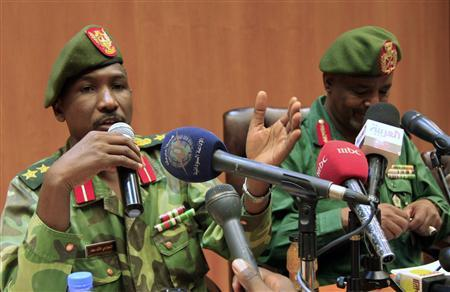 Northern military spokesman Al-Sawarmi Khaled (L) speaks during a joint news conference with Deputy of Sudanese Army Intelligence Sideque Amer Hassan in Khartoum May 20, 2011. REUTERS/Mohamed Nureldin Abdallah
