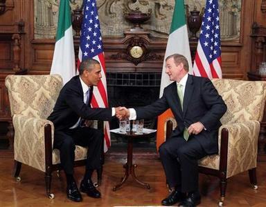 U.S. President Barack Obama (L) poses with Ireland's Prime Minister Enda Kenny during their meeting in Farmleigh near Dublin May 23, 2011. REUTERS/Maxwell's/POOL