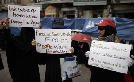 Women carry placards during an anti-government rally against Yemen's President Ali Abdullah Saleh in Sanaa May 23, 2011. REUTERS/Ammar Awad