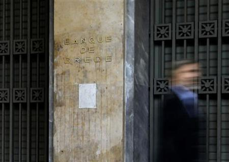 A man walks past the Bank of Greece in Athens May 9, 2011. REUTERS/Yiorgos Karahalis