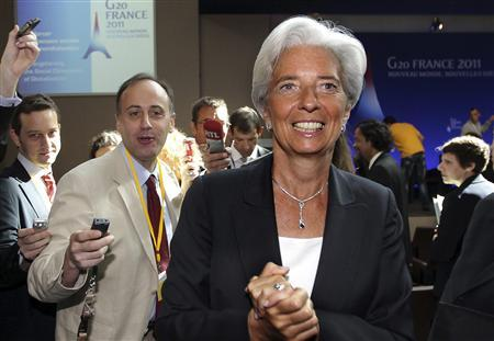 France's Finance and Economy Minister Christine Lagarde is followed by members of the media after attending a G20 Globalisation conference in Paris, May 23, 2011. REUTERS/Bob Edme/Pool