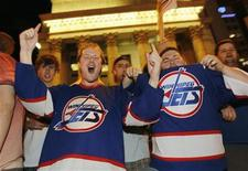 <p>Hockey fans cheer at the corner of Portage and Main in downtown Winnipeg after media reports of the Atlanta Thrashers hockey team moving to Winnipeg, May 19, 2011. REUTERS/Shaun Best</p>