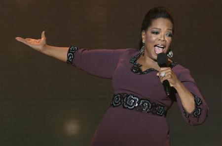Oprah Winfrey gestures during the taping of ''Oprah's Surprise Spectacular'' in Chicago May 17, 2011. Winfrey kicked off one of her last-ever national talk shows on Tuesday with hugs from Tom Hanks, Tom Cruise and Madonna in a packed Chicago arena. REUTERS/John Gress