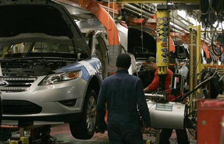 Workers place tires on the 2011 Ford Explorer and other vehicles at the Ford assembly plant in Chicago, Illinois, December 1, 2010. REUTERS/Frank Polich