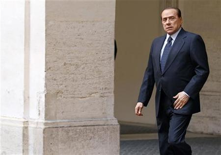 Italian Prime Minister Silvio Berlusconi walks as he waits for Gabon President Ali Bongo Ondimba at Chigi palace in downtown Rome May 17, 2011. REUTERS/Alessandro Bianchi