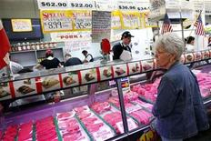 <p>A woman waits at a meat counter in the Broadway Market in Buffalo, New York April 10, 2011. REUTERS/Eric Thayer</p>