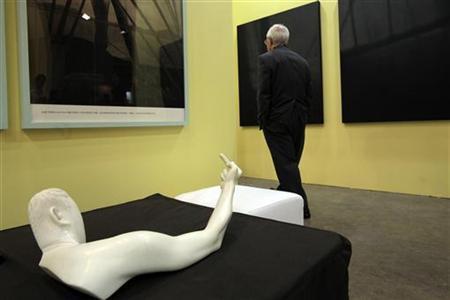 A man walks past the sculpture titled ''Marble Arm'' by Chinese dissident artist Ai Weiwei at Hong Kong International Art Fair May 25, 2011. REUTERS/Tyrone Siu