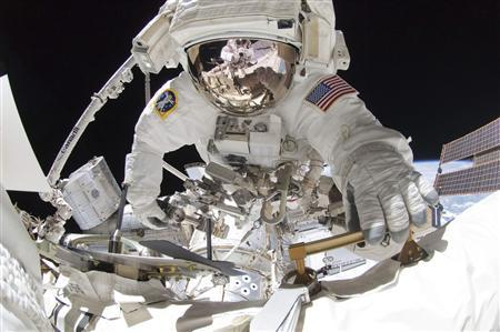 Space Shuttle Endeavour astronaut Greg Chamitoff is seen outside the International Space Station in this photo taken using a digital camera with a fish-eye lens by fellow spacewalker Mike Fincke and provided by NASA May 27, 2011. REUTERS/NASA/Handout