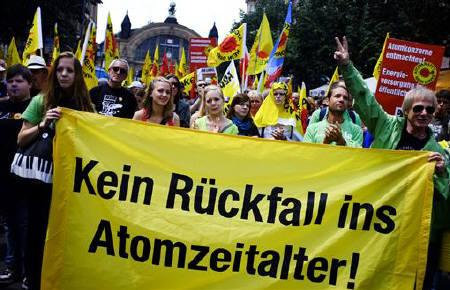 Several thousands protesters take part at an anti-nuclear demonstration in Frankfurt May 28, 2011. Words on the transparent in front read: ''No return into a nuclear age''. REUTERS/Kai Pfaffenbach