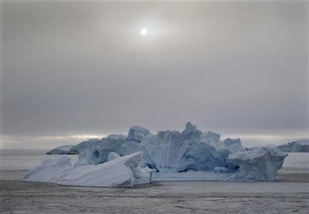 An iceberg floats in the sea ice near the town of Uummannaq in western Greenland March 18, 2010. REUTERS/Svebor Kranjc