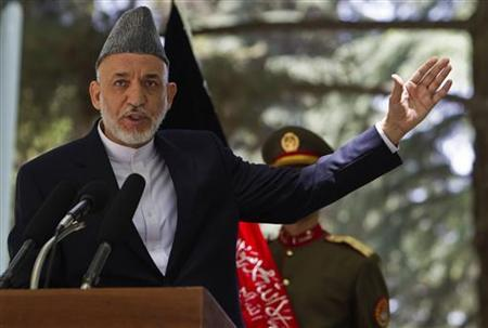 Afghanistan's President Hamid Karzai gestures as he speaks during a news conference in Kabul May 31, 2011. REUTERS/Ahmad Masood