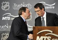 <p>NHL Commissioner Gary Bettman (L) shakes hands with True North Sports and Entertainment Chairman Mark Chipman as they attend a news conference in Winnipeg, Manitoba, May 31, 2011. REUTERS/Fred Greenslade</p>