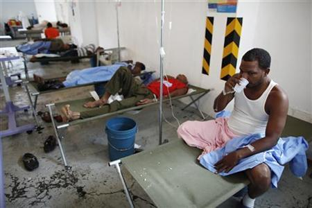 Patients suffering from cholera symptoms rest inside a local hospital in Santo Domingo May 26, 2011. REUTERS/Eduardo Munoz