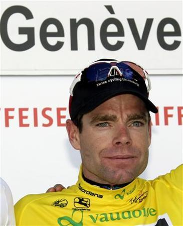 BMC's team rider Cadel Evans of Australia celebrates on the podium after winning the Tour de Romandie cycling race in Geneva May 1, 2011. REUTERS/Denis Balibouse