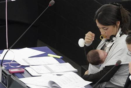 Italy's Member of the European Parliament Licia Ronzulli takes part with her baby in a voting session on the working conditions of women at the European Parliament in Strasbourg, October 20, 2010. REUTERS/Jean-Marc Loos