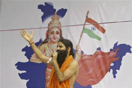 Yoga guru Swami Ramdev speaks in support of social activist Anna Hazare during a ''fast unto death'' campaign in New Delhi April 8, 2011. REUTERS/B Mathur/Files