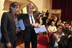 <p>Belgian lawyers Walter Van Steenbrugge (L) and Christine Mussche (2nd L) arrive at a news conference in Ghent June 1, 2011. Lawyers representing sexual abuse victims announced a class action suit against the Catholic Church because of the abuse scandal. They plan to name the Belgian bishops, heads of religious orders and the Vatican. REUTERS/Eric Vidal</p>