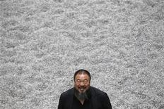 <p>Chinese artist Ai Weiwei poses for a photograph with his new installation entitled 'Sunflower Seeds', at its unveiling in the Turbine Hall at the Tate Modern gallery, in London October 11, 2010. REUTERS/Stefan Wermuth</p>
