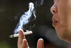<p>A man smokes outside the Taipei railway station January 13, 2010. REUTERS/Pichi Chuang</p>