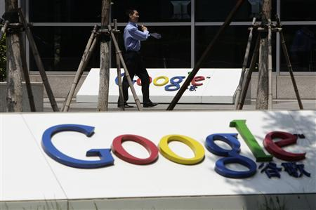 A security personnel walks past the logo of Google in front of its former headquarters in Beijing June 2, 2011. REUTERS/Jason Lee