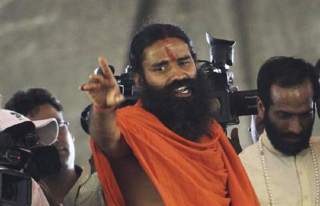 Yoga guru Swami Ramdev speaks during a news conference in New Delhi June 1, 2011. REUTERS/Stringer