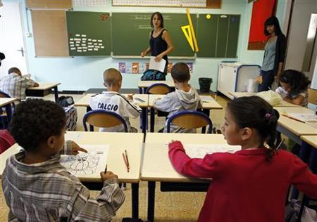 School children study during a class in a primary school in Marseille, September 2, 2010 on the start of the new school year in France. REUTERS/Jean-Paul Pelissier