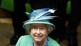 <p>Britain's Queen Elizabeth smiles as she walks around the English Market in Cork May 20, 2011. REUTERS/Cathal McNaughton</p>