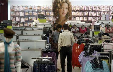 People shop in a store at a in Mumbai November 20, 2008. REUTERS/Punit Paranjpe/Files