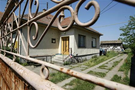 A general view of the house where General Ratko Mladic was arrested on Thursday in the village of Lazarevo near the northeastern town of Zrenjanin around 100 km (60 miles) from the capital Belgrade, May 27, 2011. REUTERS/Ivan Milutinovic/Files