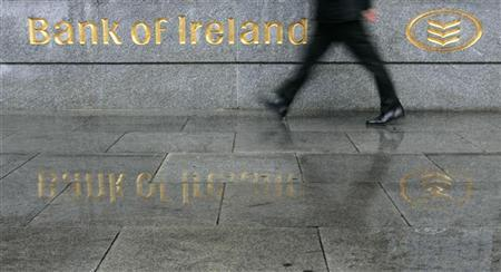 A man walks past the head office of the Bank of Ireland in Dublin May 28, 2007. REUTERS/Luke MacGregor