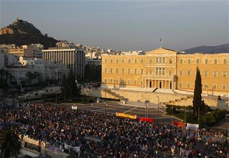 Protesters stand in front of the Greek parliament during a rally against a new austerity package in Athens' Constitution (Syntagma) square June 1, 2011. REUTERS/Yannis Behrakis
