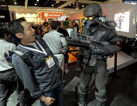Tao Yunsheng reacts to a game character at the Sony PlayStation display at the Electronic Entertainment Expo (E3) in Los Angeles, California June 15, 2010. REUTERS/Gus Ruelas
