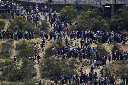 Protesters take part in a demonstration close to the Syrian-Israeli border fence near the Druze village of Majdal Shams in the Golan Heights June 5, 2011. REUTERS/Ronen Zvulun