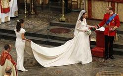<p>Maid of Honour, Pippa Middleton (L) holds the wedding dress of her sister Catherine, Duchess of Cambridge, after her she married Britain's Prince William at Westminster Abbey, in central London April 29, 2011. REUTERS/Kirsty Wigglesworth/Pool</p>