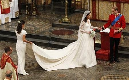 Maid of Honour, Pippa Middleton (L) holds the wedding dress of her sister Catherine, Duchess of Cambridge, after her she married Britain's Prince William at Westminster Abbey, in central London April 29, 2011. REUTERS/Kirsty Wigglesworth/Pool