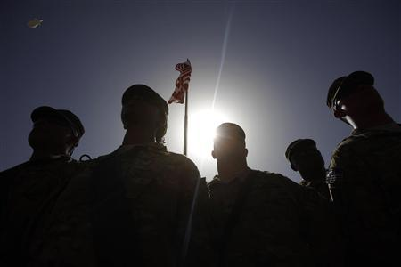 U.S. soldiers listen to Secretary of Defense Robert Gates at he meets with them at Forward Operating Base (FOB) Shank in Logar Province, Afghanistan, June 6, 2011. REUTERS/Jason Reed