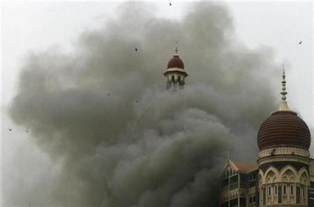 The Taj Mahal hotel is seen engulfed in smoke during a gun battle in Mumbai November 29, 2008. REUTERS/Arko Datta